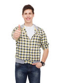 Smiling student boy showing thumbs up — Stock Photo