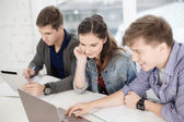 Students with laptop, notebooks and tablet pc — Stock Photo