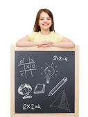 Smiling girl with blackboard — Stock Photo