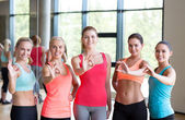 Group of women showing ok sign in gym — Stock Photo