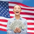 Laughing businesswoman with dollar cash money — Stock Photo #50811911