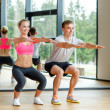 Smiling man and woman in gym — Stock Photo #50815245