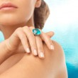 Closeup of woman hand with big blue cocktail ring — Stock Photo