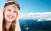 Smiling teenage girl in snowboard goggles — Stock Photo
