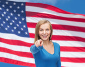 Smiling student pointing finger at you — Stock Photo