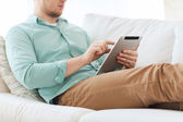 Close up of man with tablet pc computer at home — Stock Photo