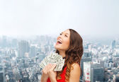 Woman in red dress with us dollar money — Stock Photo