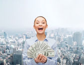 Laughing businesswoman with dollar cash money — Stock Photo