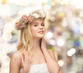 Young woman wearing wreath of flowers — Stock Photo