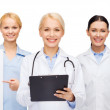 Smiling female eye doctors and nurses — Stock Photo #51133967