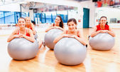 Smiling people working out in pilates class — Stok fotoğraf