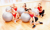 Smiling people working out in pilates class — Stock Photo