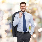 Smiling young and handsome businessman — Stock Photo