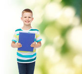 Smiling little student boy with blue book — Stockfoto