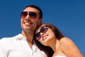 Smiling couple over blue sky background — Stock Photo