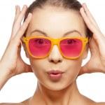 Surprised teenage girl in pink sunglasses — Stock Photo
