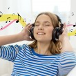 Smiling young girl in headphones at home — Stock Photo #51194003