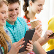 Smiling students with tablet pc at school — Stock Photo #51194897