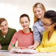 Students with textbooks and books at school — Stock Photo #51195029