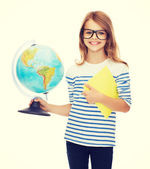 Smiling child with globe, notebook and eyeglasses — Stock Photo