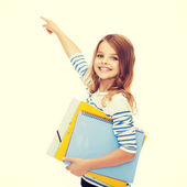 Cute girl with folders pointing at virtual screen — Stock Photo