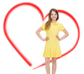 Smiling little girl in yellow dress — Stock Photo