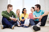 Five smiling teenagers having fun at home — Stock Photo