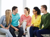 Five smiling teenagers having fun at home — Stockfoto