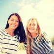 Smiling girlfriends having fun on the beach — Stock Photo #51252921