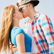 Smiling couple with skateboard kissing outdoors — Stock Photo #51255215