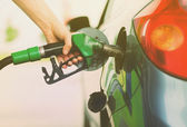 Man pumping gasoline fuel in car at gas station — Stock Photo