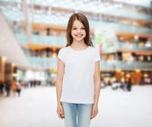 Smiling little girl in white blank t-shirt — Stock Photo