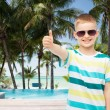 Smiling little boy over green background — Stock Photo #51306335