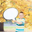 Smiling little boy with blank text bubble — Stock Photo #51307037