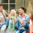 Group of smiling friends with take away coffee — Stock Photo #51308381