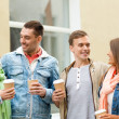 Group of smiling friends with take away coffee — Stockfoto #51308393