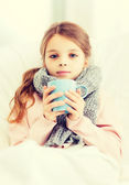 Ill girl child with cup of hot tea — Stock Photo