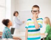 Smiling little boy in eyeglasses — Stock Photo