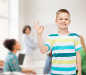 Little boy in casual clothes making ok gesture — Stock Photo