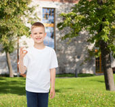Smiling little boy in white blank t-shirt — Stock Photo