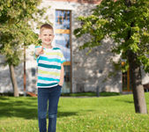 Smiling little boy pointing finger at you — Stock Photo