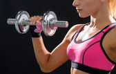 Close up of sporty woman with heavy steel dumbbell — Stock Photo