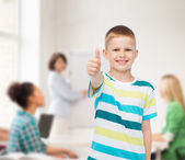 Little boy in casual clothes with arms crossed — Stock Photo