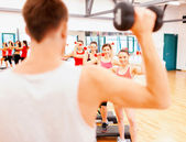 Group of smiling female with dumbbells and step — Stockfoto