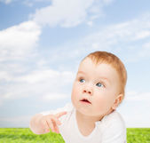 Curious baby looking side — Stock Photo