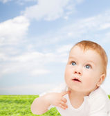 Curious baby looking up — Stock Photo