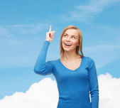 Smiling woman pointing her finger up — Stock Photo