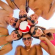 Smiling friends in circle on summer beach — Stock Photo #51351971