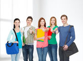 Group of smiling students standing — Stock Photo
