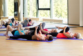 Group of women stretching in gym — ストック写真